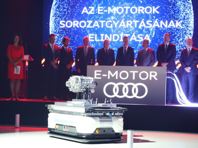 Series production of electric motors officially started in Gy?r. The electric motors are produced on floor space of 8,500 square meters with an innovative production concept: modular assembly.  The guests of honor at the official start of production of electric motors at Audi Hungaria. In the picture (from left to right): Mónika Czechmeister (Head of External Communications at Audi Hungaria), Jens Baumann (project management electric motors), Lóránt Székely (Head of production of electric motors), Achim Heinfling (Managing Director of Audi Hungaria), Peter Kössler (Board of Management Member for Production and Logistics at AUDI AG), Péter Szijjártó (Minister for Foreign Trade and Foreign Affairs), Róbert Balázs Simon (Member of Parliament), Herbert Steiner (Member of the Board of Management for Engine Production at Audi Hungaria) and Dr. Jari Hyvönen (Head of manufacturing planning of electric motors).