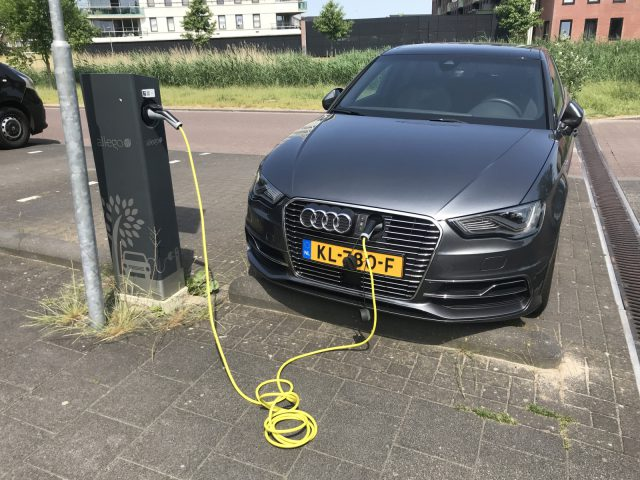Almere, Netherlands - May 27, 2018: Audi A3 Sportback E-Tron electric car being charged at a Allego charge point.